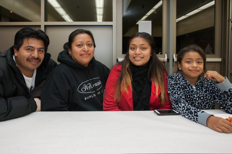 Ana Hernandez, seated second from left, is PTA chapter president at Junipero Serra Elementary in Bernal Heights, where her daughter Jasmine (far right, next to her big sister) goes to school. Hernandez emigrated from Guatemala in 2004, fleeing poverty and a society shattered by 50 years of civil war. Today, she supports the entire family working 42 hours a week as a cook in Burlingame. Her husband, Byron, lost one of his fingers in an accident on his job as a laundry mechanic, and as a result he is out of work. Despite her inflexible and demanding schedule, Hernandez said she stays involved with the PTA because it gives her life meaning and community. But for the family to make ends meet, she needs a second job. If she succeeds in finding one, she said she would have to quit leading the PTA. Photo: Luke Thomas / San Francisco Public Press