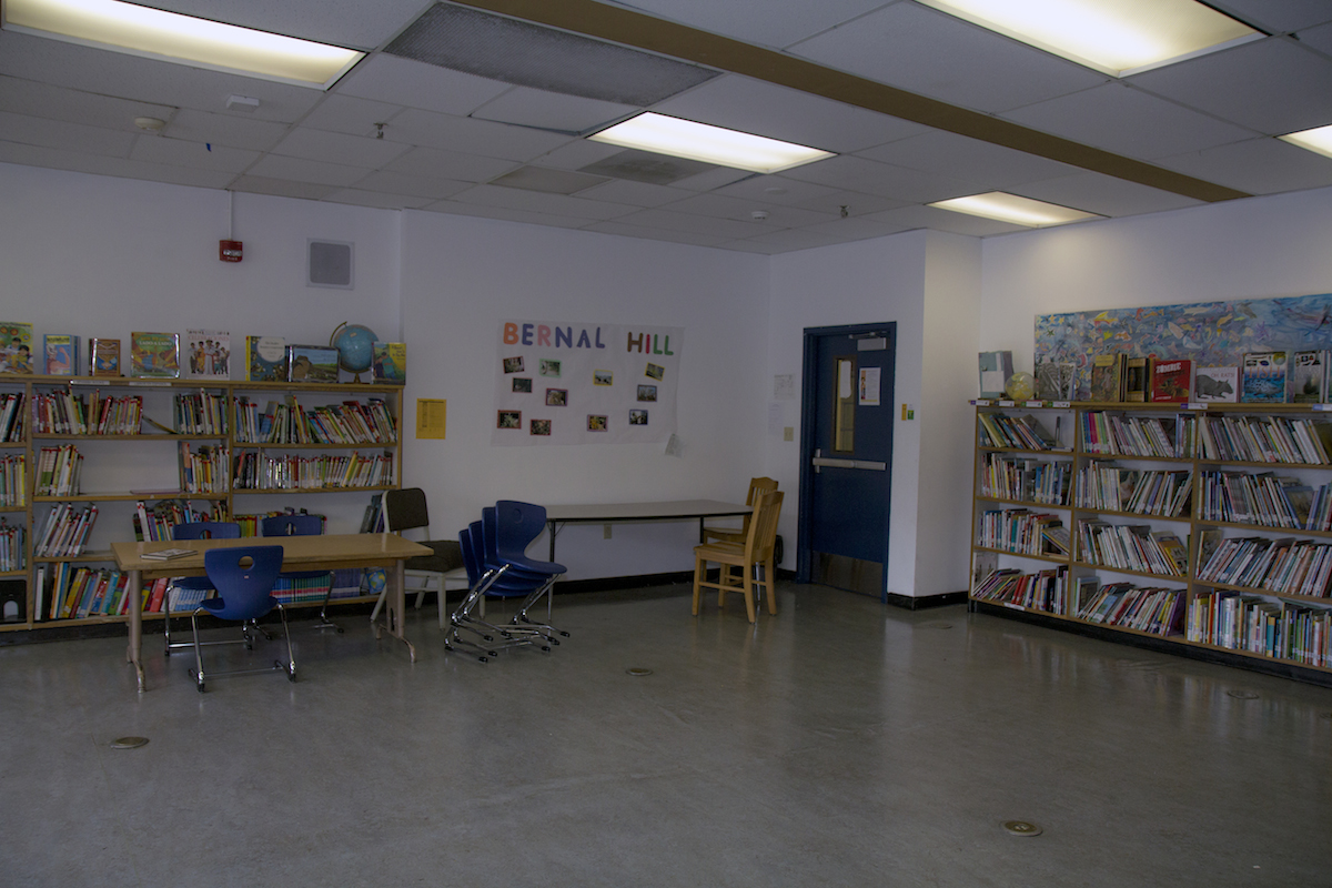 """After years of cuts, the Junipero Serra library now has an annual budget of just $500. Many parents said the library was actually improved in recent years, thanks to book donations and volunteer efforts. Even so, the shelves feel underpopulated, and the room under-used. With a limited budget, Principal Evelyn Cheung had to make hard choices, so she prioritized the computer lab and technology training for the kids ahead of other costs. Hernandez supports Cheung's priorities, and the PTA has been able to buy computers for the lab. """"Some people think the government pays for everything at school, but it's not like that,"""" she said. """"I try to explain to the parents: We have to make fundraising, because that is how we can help the school."""" Photo: Tearsa Joy Hammock / San Francisco Public Press"""