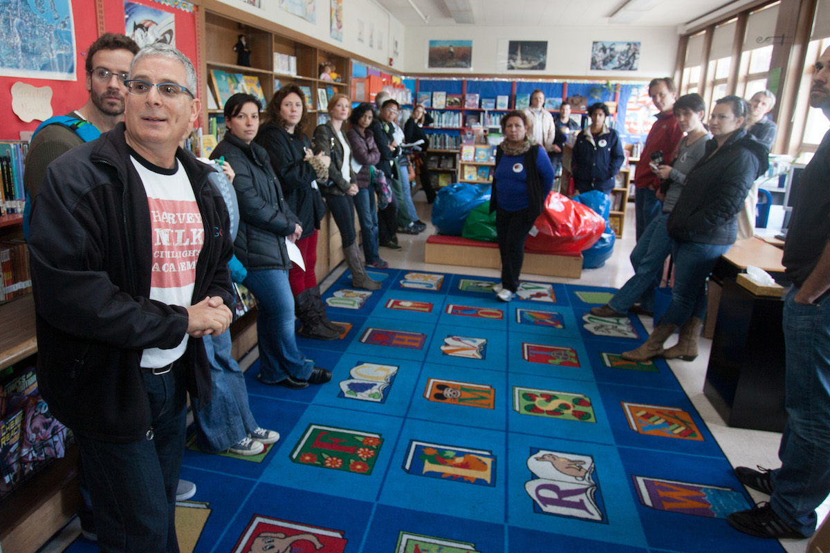 """Schmell shows off the school library to a group of parents who are considering sending their children to Harvey Milk Civil Rights Academy. By giving tours and organizing frequent """"fun raisers,"""" Schmell is working to revitalize a school that has struggled around issues of funding equity, race and social class, as well as management. A nonprofit organization, Friends of Harvey Milk, was one of the top fundraisers in the city, spending $380,000 a year, almost exclusively on before-school and after-school enrichment programs. But that collapsed in 2011 after key supporters withdrew, leaving the school with little fundraising infrastructure. """"If we had everyone at Harvey Milk give $250 for the year, then we wouldn't have to do severe fundraising,"""" he said. """"I'm very concerned about technology. I'd love for us to have a computer lab, and we need to do a targeted fundraising campaign for that."""" Photo: Luke Thomas / San Francisco Public Press"""