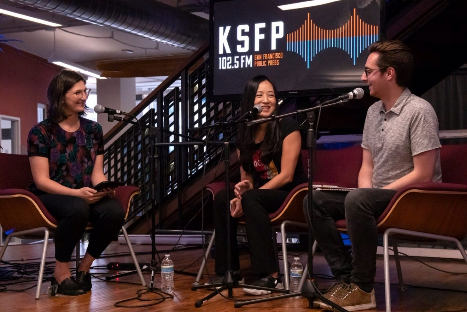 "Laura Wenus interviews Eugenia Chien and Peter Clarke of Muni Diaries during the KSFP and ""Civic"" launch event at the Impact Hub in San Francisco on Aug. 19, 2019. Photo by Yesica Prado / San Francisco Public Press"