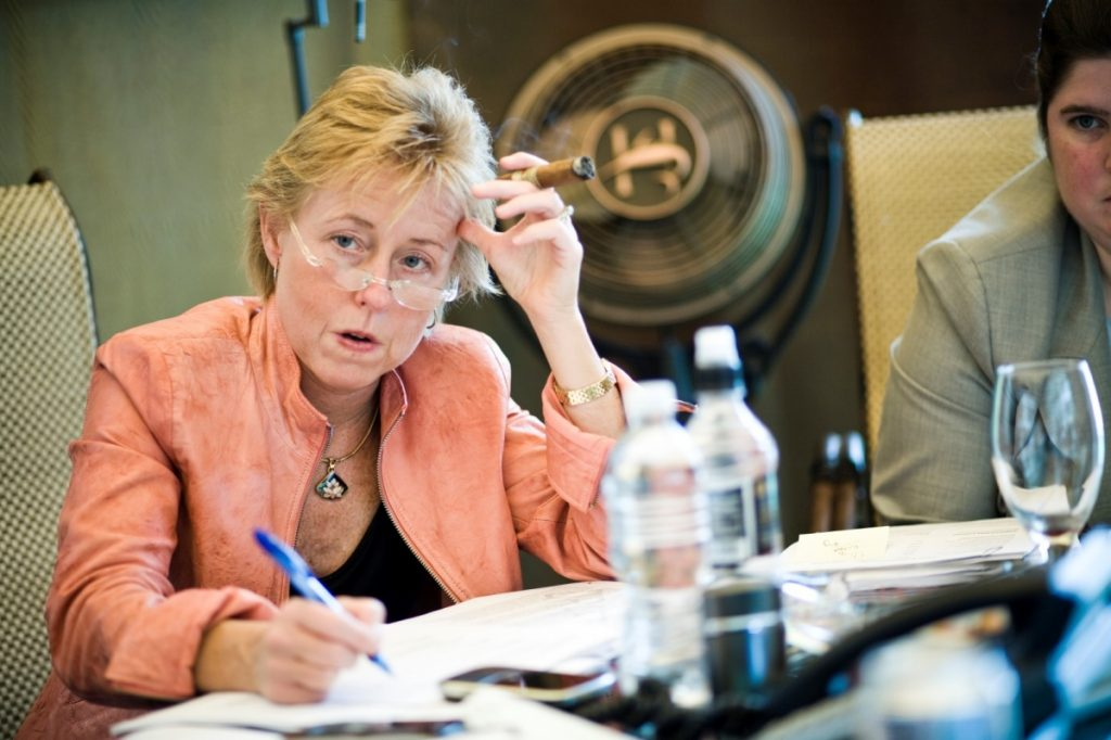After working as a commissioner and Gov. Arnold Schwarzenegger's chief of staff, Susan P. Kennedy (seen here at a meeting in Schwarzenegger's smoking tent at the Capitol) went to lobby for Lyft in late 2012, just as the utilities commission was considering how to regulate the new ride-hailing companies. Photo by Max Whittaker for the Wall Street Journal