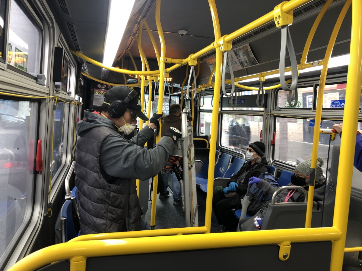 Passengers on the 24 Divisadero bus in San Francisco on April 6 protect themselves with masks. The 24 was among the bus routes considered part of the core service and it wasn't cut.
