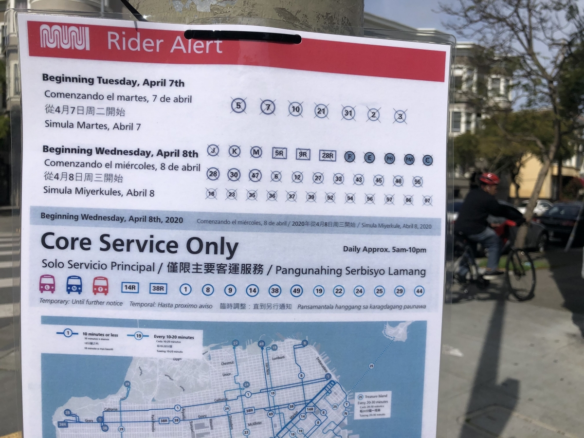 A Rider Alert sign listing dozens of cut bus routes along with a map showing the remaining core service routes was displayed at a temporarily decommissioned bus stop on April 8.