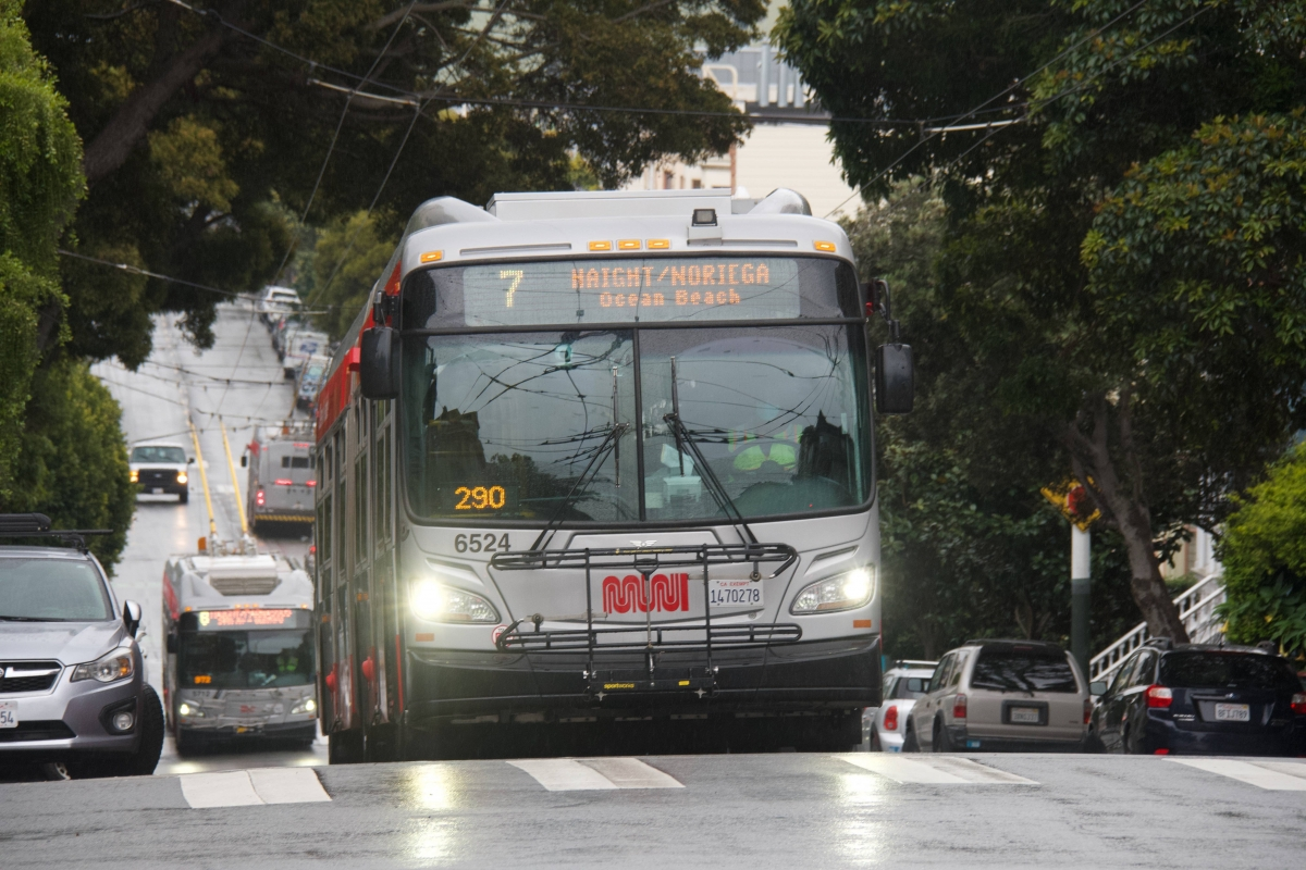 Two 6 Haight/Parnassus buses cross paths behind a 7 Haight/Noriega bus on Haight Street at Divisadero Street on April 6. Both routes were cut.