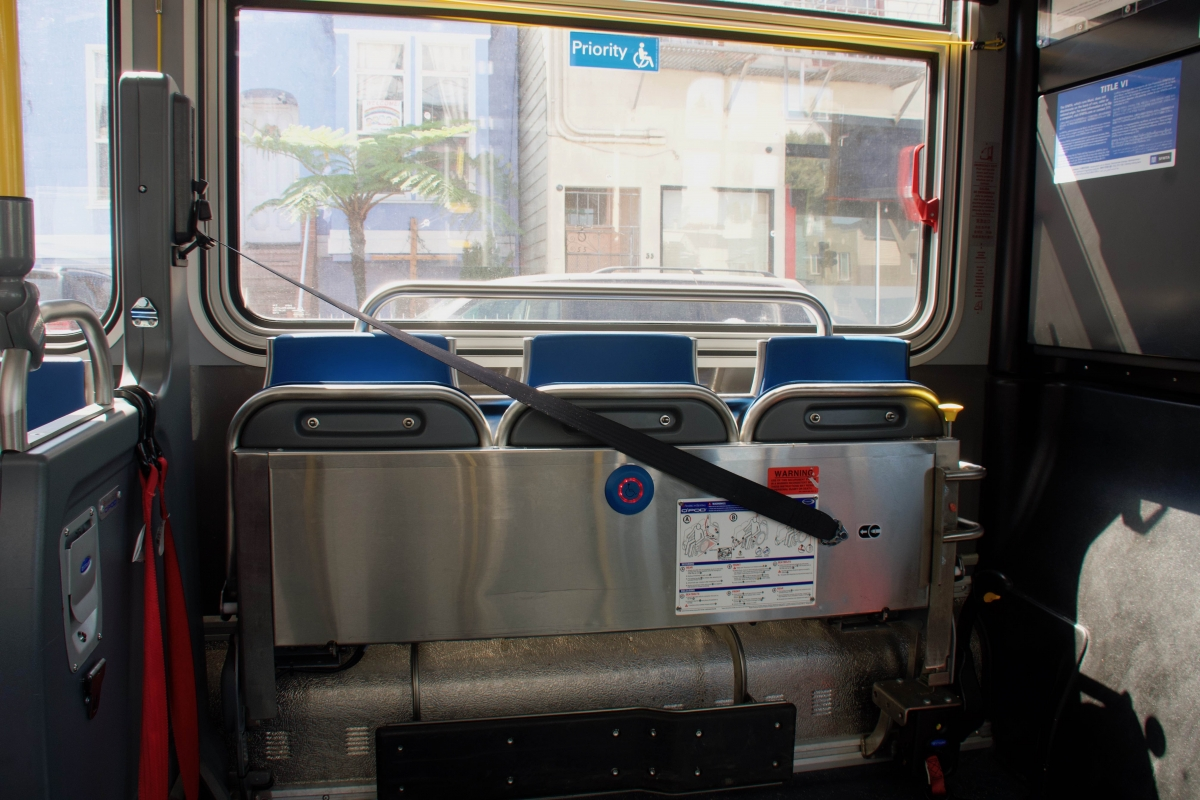 The front seats on the driver's side of a Muni bus are strapped in upright position to keep riders farther from the driver on April 7.