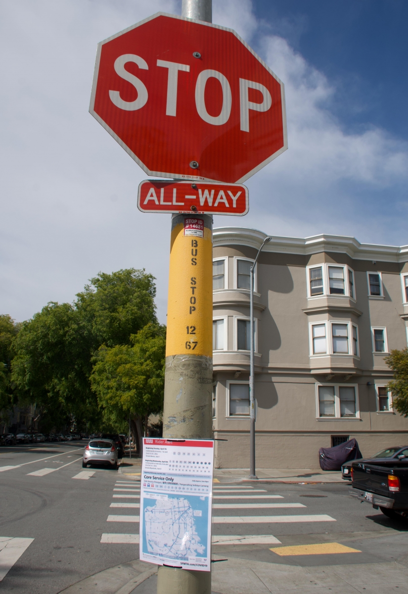 A sign explaining which bus routes had been cut and a map of remaining routes is posted at a bus stop that no longer has service from two routes on April 8. Muni workers volunteered to put up 2,000 signs at Muni stops throughout the city the night before.