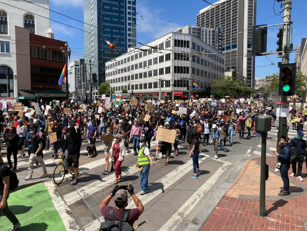 A march for racial justice and against police killings moves down Market Street at Van Ness Avenue on June 19, 2020. Brian Howey / Public Press