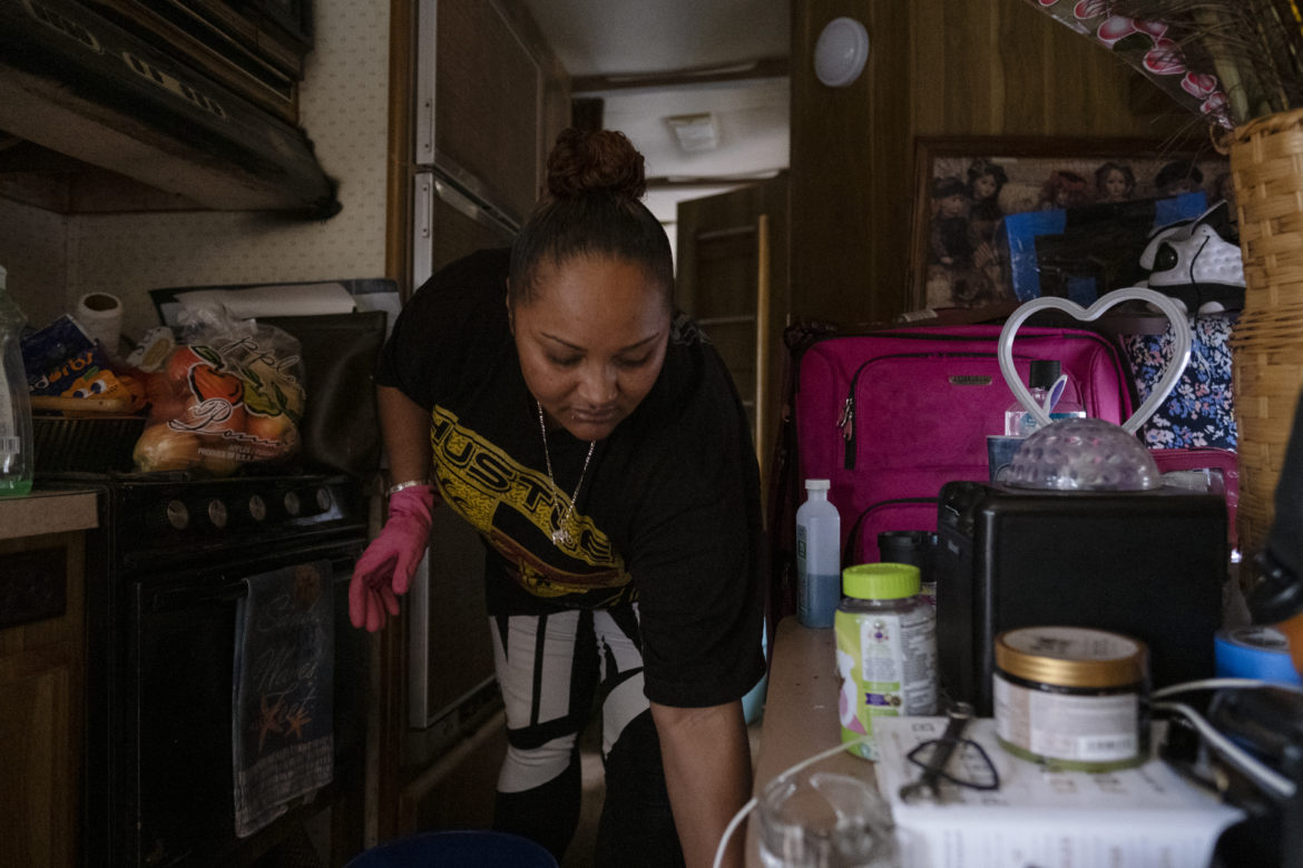 "On this morning, Tolbert prepares a bucket of water to scrubs the shower inside her recreational vehicle. She takes care of her home and is grateful to have a place to call her own. ""In Las Vegas, there's people living in tunnels,"" she said. ""Our little RV is a mansion. We are living like kings and queens compared to them over there."""