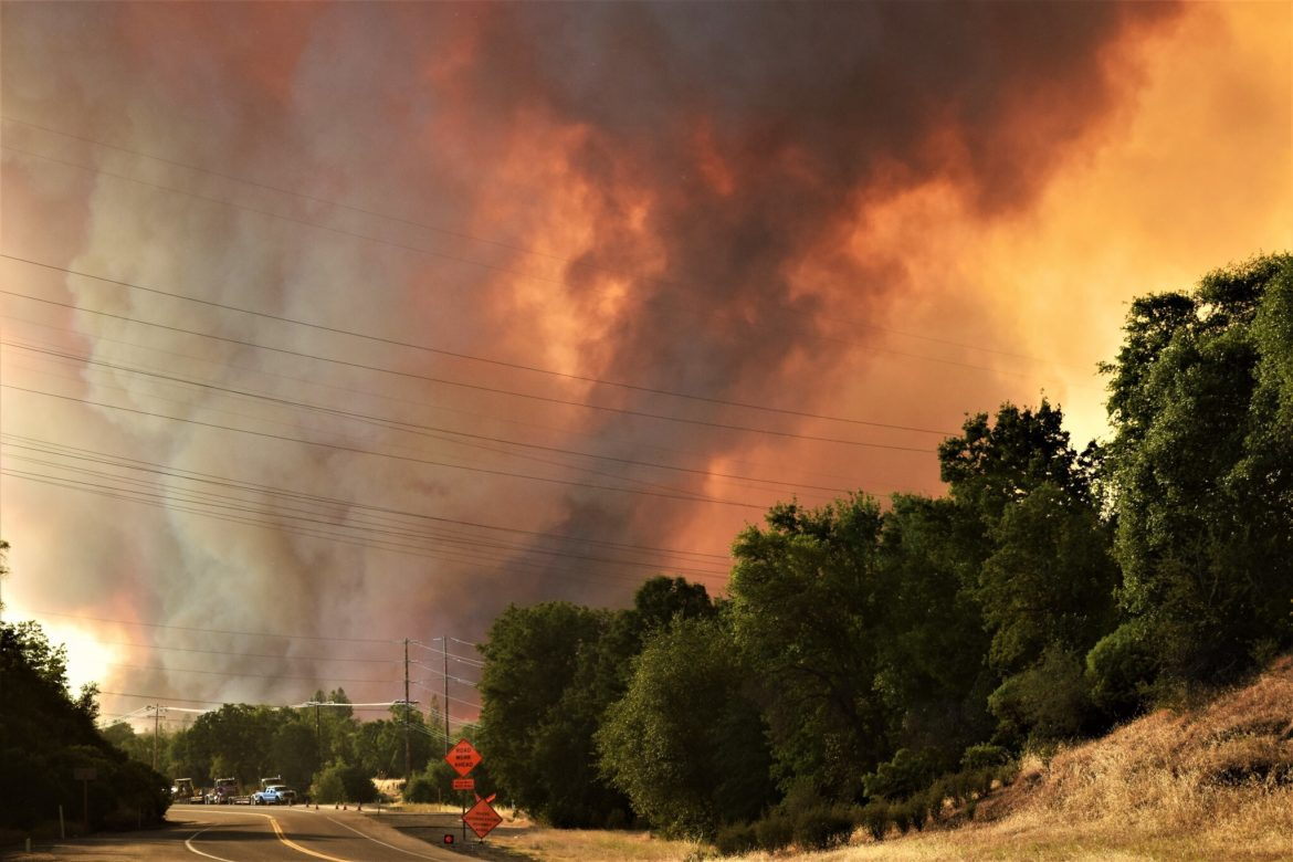 Wildfires, like the 2018 Carr Fire pictured, are one of the climate threats California may increasingly face in the coming years and that climate action plans are meant to address.