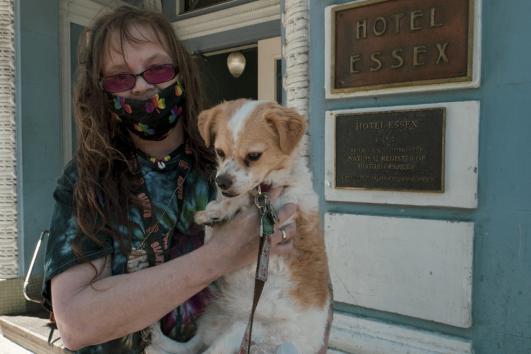 """Kristi Banks, 51, lives with her companion dog Jack, aka """"Carjack,"""" at the Hotel Essex at Ellis and Larkin streets. The single-room-occupancy hotel has been their home for 10 and a half years. Banks and Jack are inseparable. The dog gives her a sense of purpose and a schedule in her life, Banks said."""