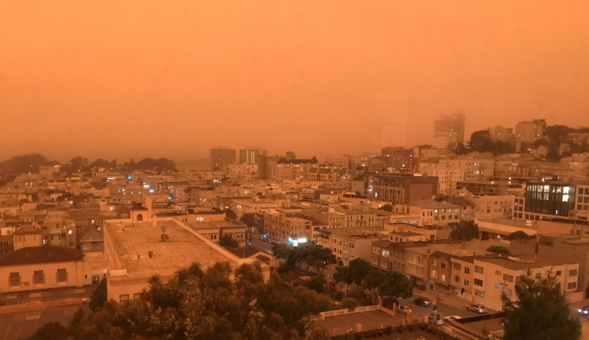 Smoke from wildfires turns the skies above San Francisco a dark orange on the morning of Sept. 9, 2020.