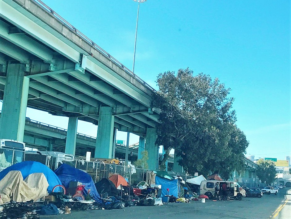 Tents housing homeless residents of San Francisco line a street below the freeway in 2017.