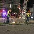 San Francisco city workers use blowtorches to remove grass and weeds from a median on Broadway at Polk Street on Feb. 3, 2020. City workers rely much less on herbicides than they did just five years ago, as health concerns mount.