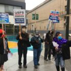 Union organizers and mail workers rally to support the postal service at Fox Plaza in San Francisco on Nov. 17, 2020