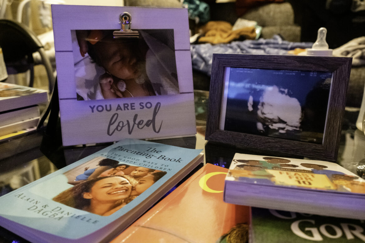 "Supreme's ultrasound and firstborn pictures sit on a glass table in Tolbert's living room. She reads children's books to her baby such as ""Corduroy"" and ""Feast for 10,"" which are a few of her favorites. During Supreme's nap times, Tolbert reads her parenting book, ""The Good Ways to Raise Happy Children."""