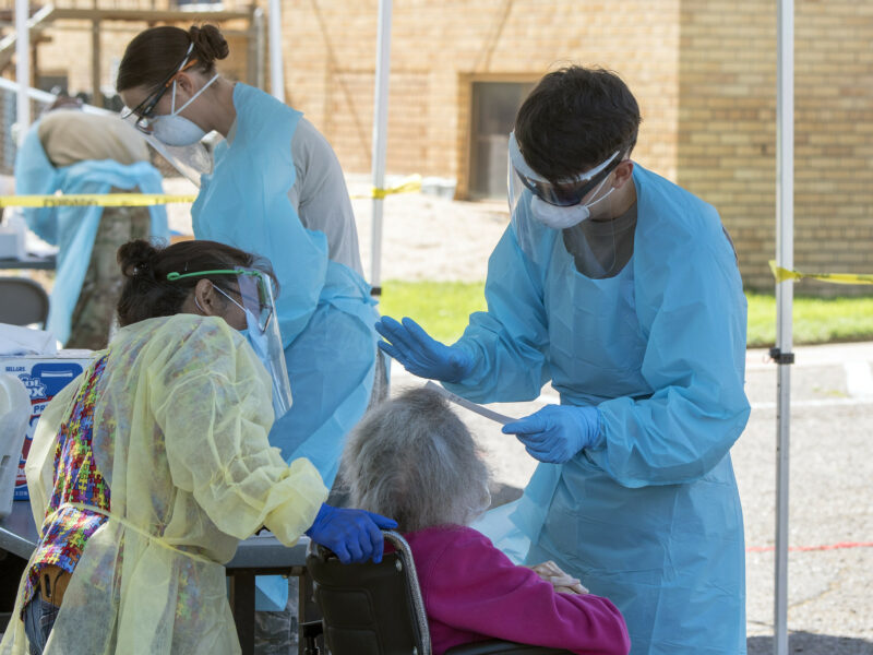 U.S. Army Spc. Sterling Hutcheson, a medic with the Colorado National Guard Joint Task Force Test Support, prepares to swab a nursing home resident during COVID-19 testing in Rocky Ford, Colo. on May 29, 2020.