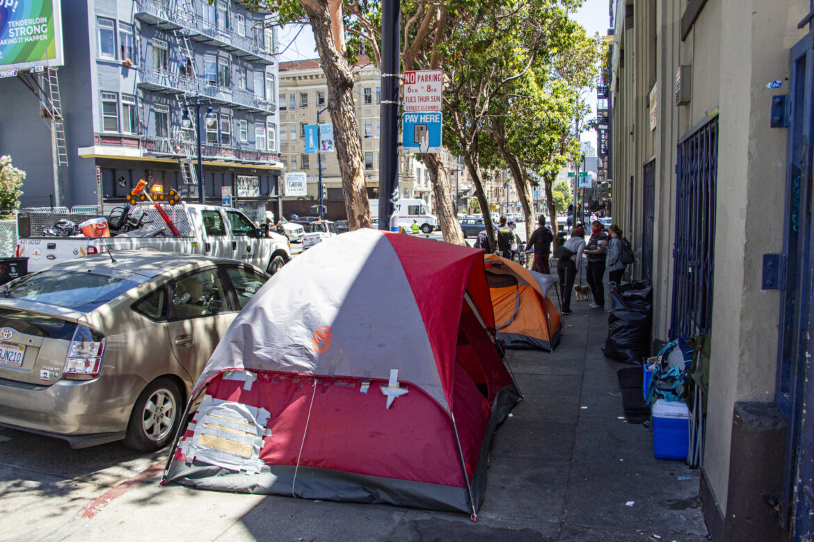 Tents line Golden Gate Avenue while nonprofit and city workers discuss hotel placements with unhoused residents in July 2020.