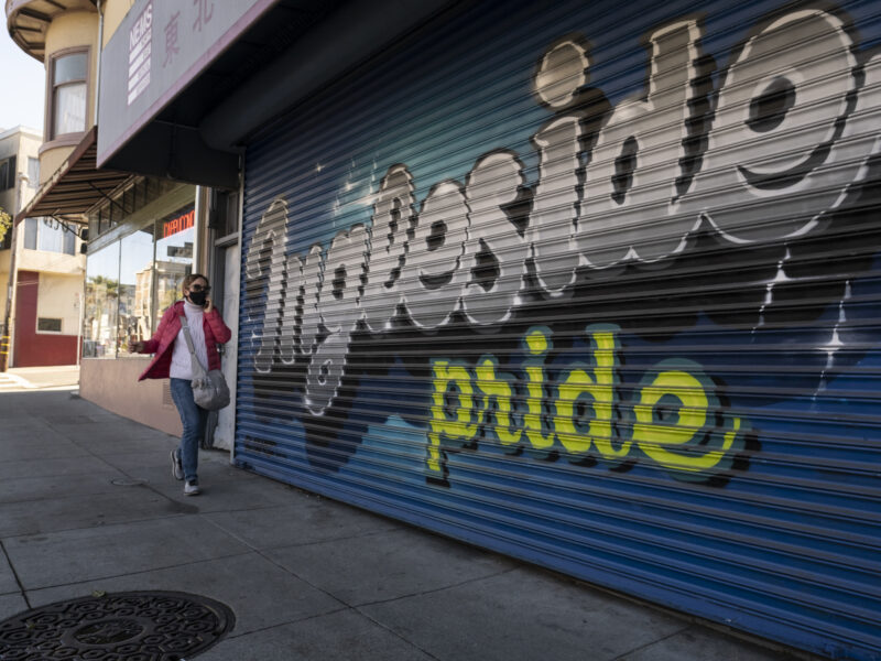 """A woman chats on her phone, wearing a mask,while walking down Ocean Avenue in early January.She strolls pass a mural highlighting, """"Ingleside Pride,"""" painted on a closed medical business. Residents in the neighborhoods of Ingleside, Excelsior, Mission and the Tenderloin are struggling to continue paying rent.Despite the region's high rents, the percentage of San Francisco area residents who are behind on their rent is lower than the national average."""