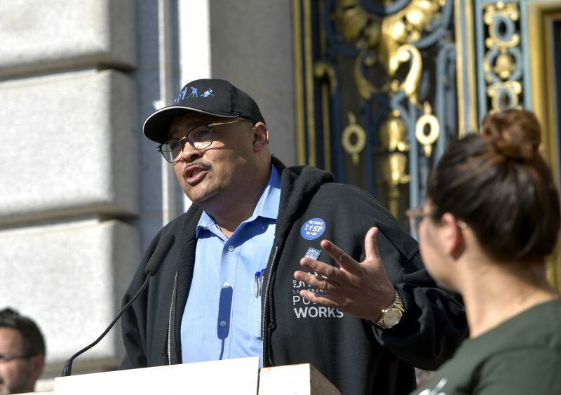 Former San Francisco Public Works Director Mohammed Nuru speaks at a rally asking for walking safety during seventh annual Walk to Work Day at City Hall on April 10, 2019. Speaker of the House Nancy Pelosi, left, and San Francisco Mayor London Breed, center, join then-Transbay Joint Powers Authority Board Chair Mohammed Nuru in turning on a bus schedule screen to celebrate the opening of the new Salesforce Transit Center. Nuru was arrested by the FBI in 2020 on corruption charges.