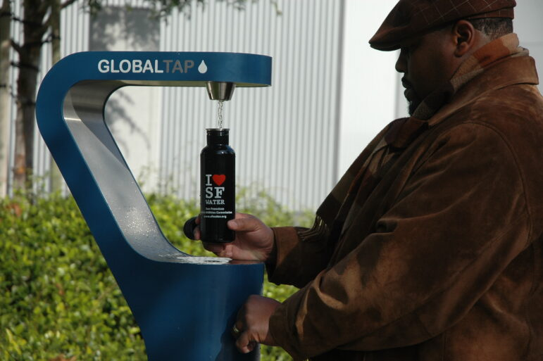 A man fills his water bottle at one of San Francisco's new permanent water fountains.