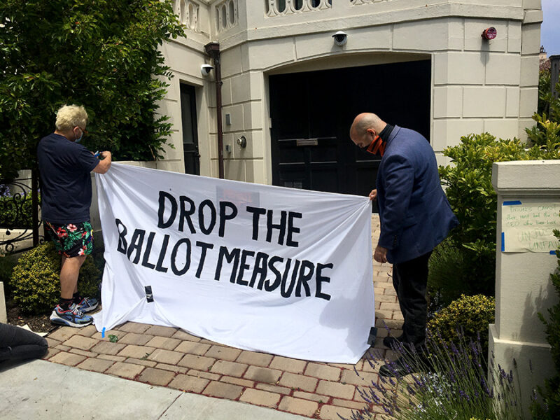 At a July 2020 car caravan and protest, ride hail drivers displayed a banner against Proposition 22 in front of Uber CEO Dara Khosrowshahi's home in San Francisco.
