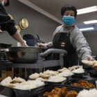 Restaurants in Chinatown and elsewhere adapt to pandemic restrictions by serving meals to the poor.