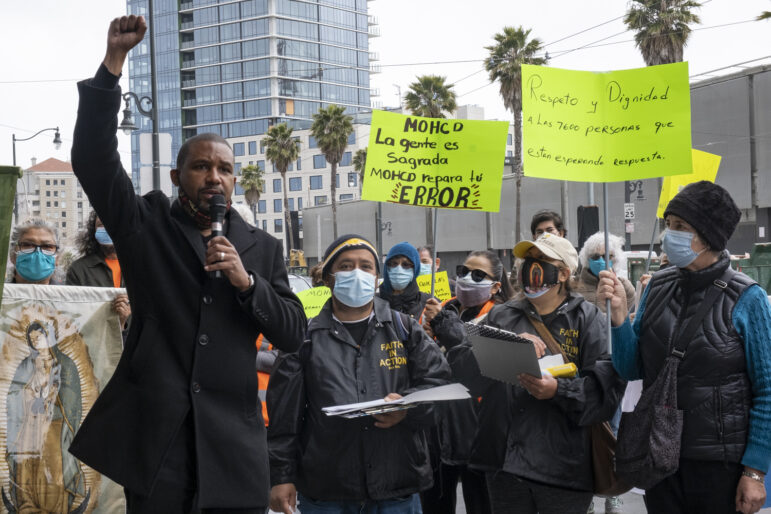 """Supervisor Shamann Walton, left, speaks alongside a small group of Faith in Action advocates who are protesting outside the city's housing office, demanding that the City's new rental assistance program include almost 7,600 applications for monetary aid submitted as part of its Give2SF program last year. Walton said he """"supports families needing family relief"""" and asks for the city to """"take into consideration people already on the list. They already have expressed the need, and now we need to help them."""""""