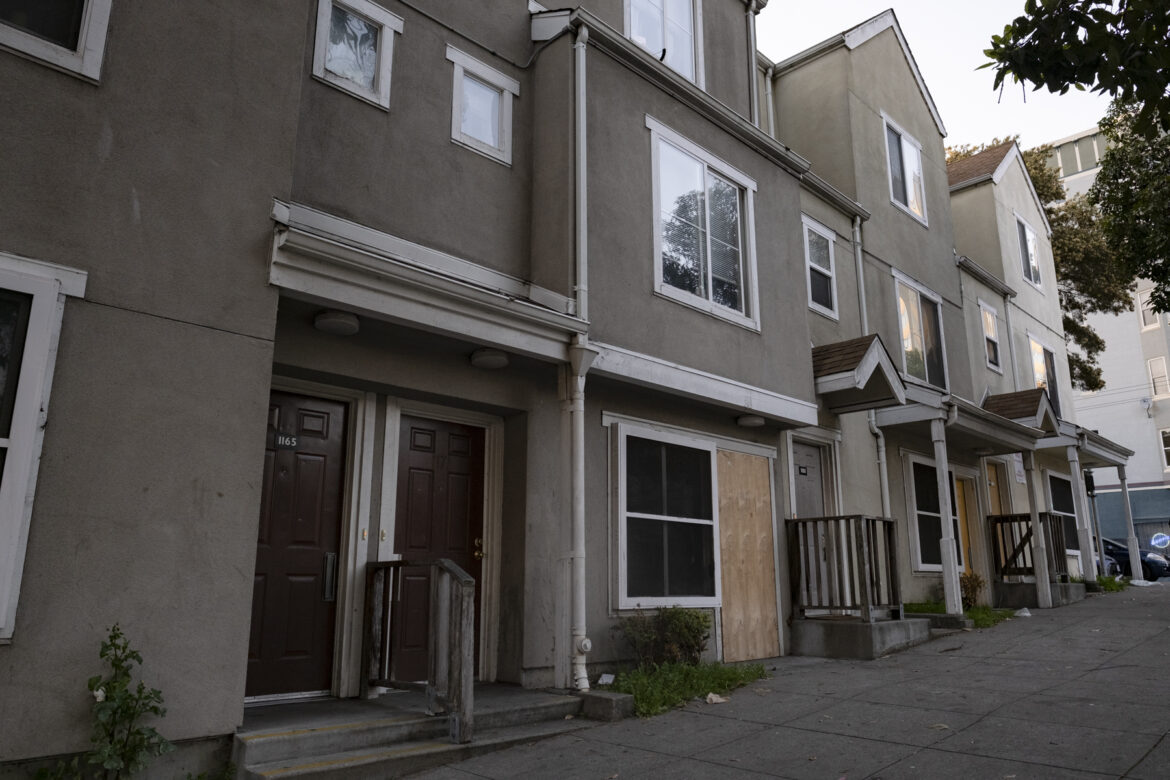 Several street-level apartments, some boarded up, are shown. San Francisco officials have agreed to loan the developer and property manager of the Plaza East housing complex $2.7 million for repairs.