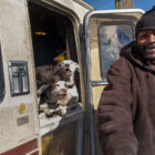Edward Armstrong smiles after petting his Pitbull dogs, which live in his recreational vehicle on Carroll Avenue in the Bayview neighborhood.
