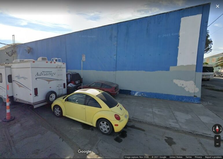 Google Street View of Carroll Avenue in November 2020. Street cleaning sign next to Armstrong's trailer.