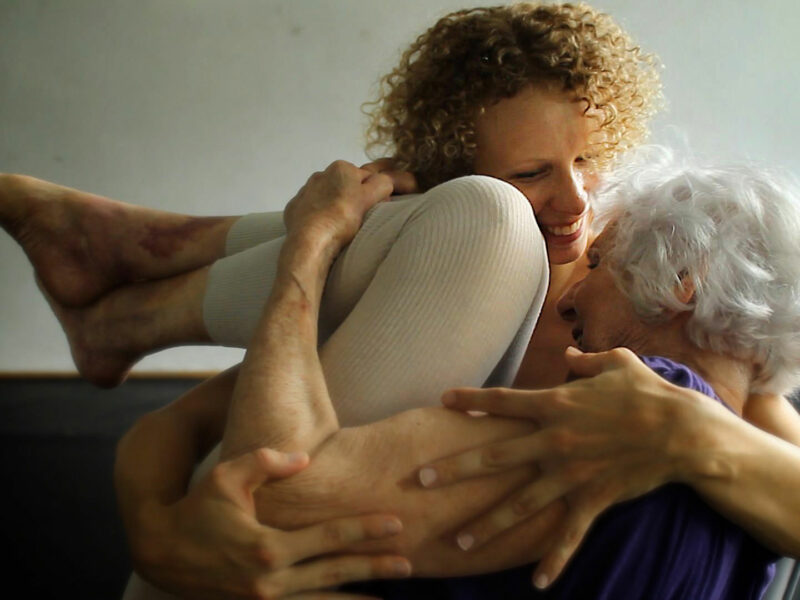 A younger dancer cradles a 90-year-old woman as they dance together. In a still from the 2019 film The Euphoria of Being, a Holocaust survivor participates in a performance with an internationally acclaimed dancer who is decades younger. The Legacy Film Festival on Aging features a slate of films exploring different aspects of aging.