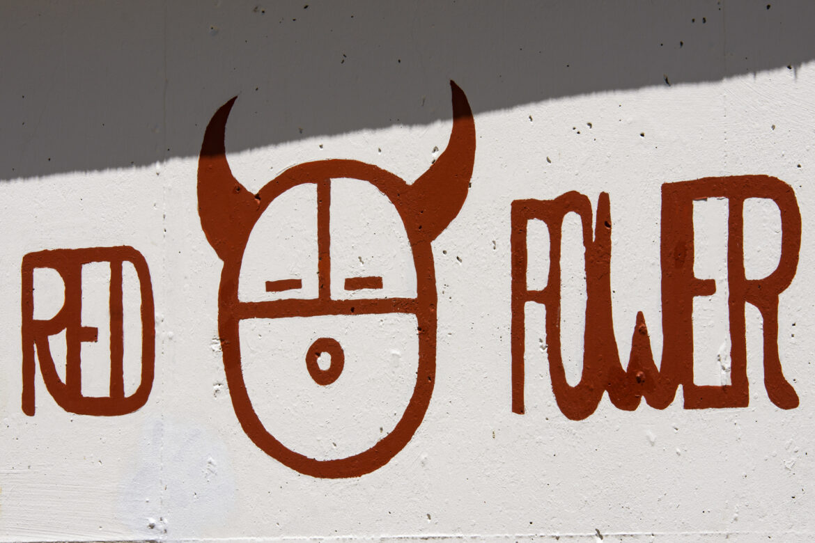 """A close-up view to the """"Red Power"""" political graffiti near Building 61."""