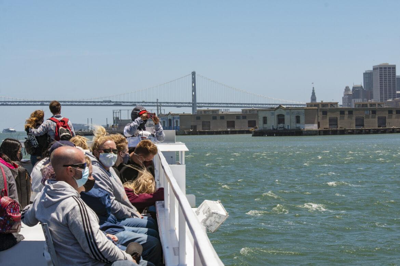 Visitors ride the Alcatraz Cruise across San Francisco Bay to return to the city.