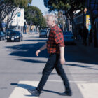 """A man, Max Wolf Valerio, crosses a street in San Francisco in a still from the documentary """"Genderation."""""""