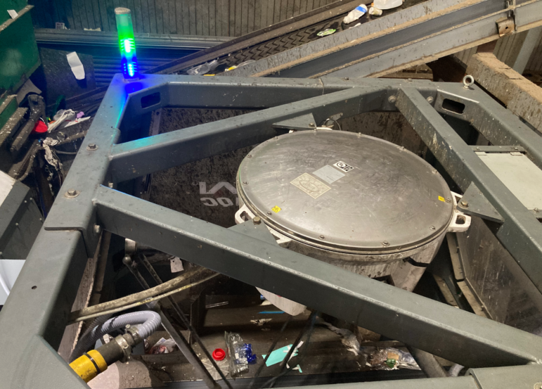 A robotic sorter picks plastic clamshell packages out of the recycling stream. Recology has found a market for this particular type of plastic packaging.