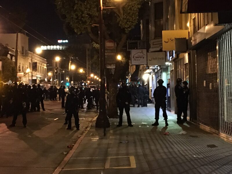 """Police form a line around a small group of protesters and one journalist held on the scene in what officers called a """"mass arrest"""" on June 3, 2020."""
