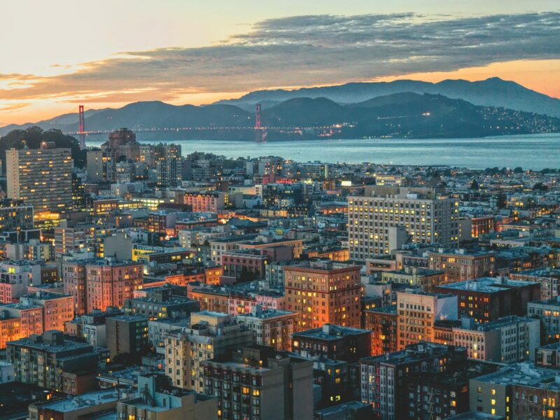 A view of San Francisco, the Golden Gate Bridge, and Marin County at sunset.