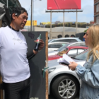 Hannah Kaplan interviews a homeless man in San Francisco while reporting about the city's navigation centers and other programs designed to help people who need housing.