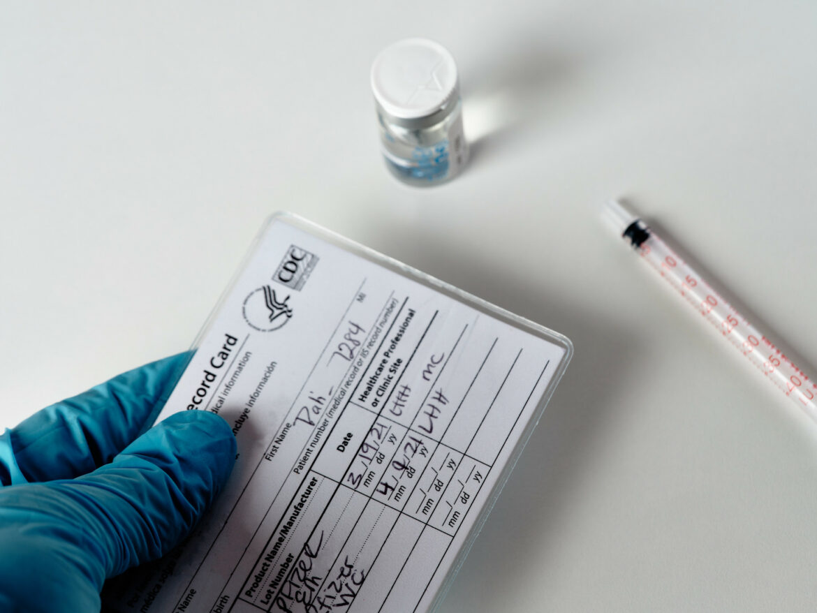 A COVID-19 vaccination card at a medical clinic.