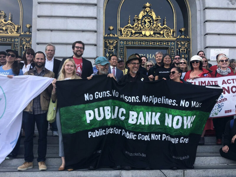 Activists rally for a public bank on the steps of San Francisco City Hall in November 2019.