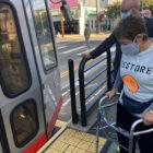 Kathy Setian, using a walker, boards the J Church train in Noe Valley.