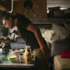 Christian Torres cooks food in the van where he lives in Berkeley.